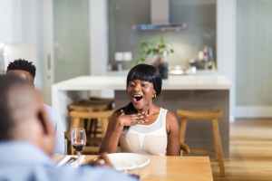 African man proposing to his girlfriend during dinner, Cape Town, South Africa